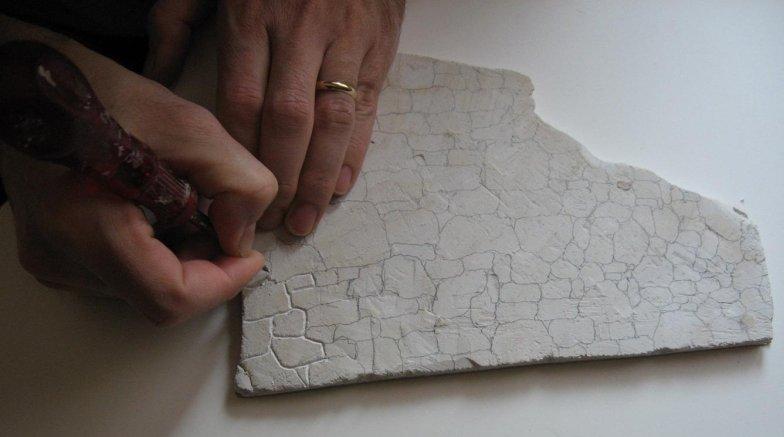 incisione pietre su cartongesso